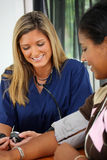 Nurse. Taking Blood Pressure Of A Patient Royalty Free Stock Photo