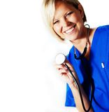 Nurse. Mature nurse in blue scrubs with stethoscope royalty free stock photography