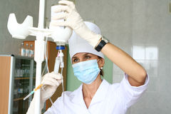 Nurse. In uniform preparing injection Stock Image