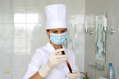 Nurse. Holding tube with blood analize Royalty Free Stock Photography