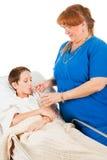 Nurse Administers Fluids Stock Photo