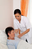 Nurse in aged care for the elderly. A nurse in aged care for the elderly in nursing homes Stock Photography