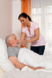 Nurse in aged care for the elderly in nursing Royalty Free Stock Images