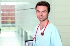 Nurse alone in a corridor Stock Image