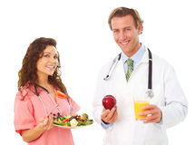Nurse And Doctor Holding Health Food Royalty Free Stock Photo