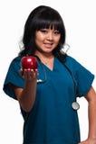 Nurse with apple Stock Image