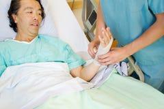 Nurse applying tensor to wrist Stock Photos