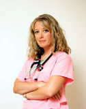 Nurse with Arms Crossed. A satisfied confident nurse takes a break from her rounds Royalty Free Stock Image
