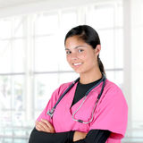 Nurse With Arms Crossed in Modern Clinic Setting Stock Photos