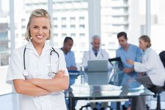 Nurse with arms crossed Stock Images