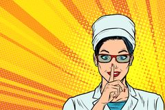 Nurse Asks For Silence, Gesture Finger To Lips Royalty Free Stock Photography