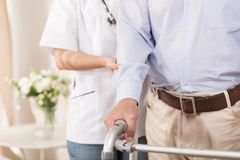 Nurse assisting an elderly man Stock Photos
