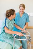 Nurse Assisting Patient Using Walker In Hospital Royalty Free Stock Image