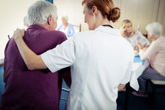 Nurse assisting a senior using a walker Royalty Free Stock Photos