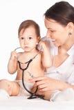 Nurse and baby Stock Image