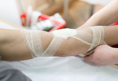 Nurse bandaging hand Royalty Free Stock Image