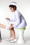 Nurse bandaging patient Stock Images