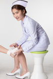 Nurse bandaging patient Stock Image