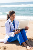 Nurse on beach Royalty Free Stock Photos