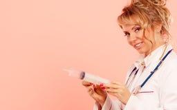 Nurse with big syringe. Stock Photo