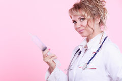 Nurse with big syringe. Stock Images