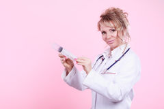 Nurse with big syringe. Stock Image
