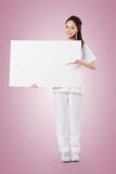 Nurse with blank board Royalty Free Stock Images