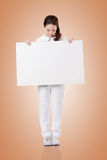 Nurse with blank board Royalty Free Stock Photo