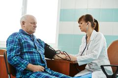 Nurse at Blood pressure medic test Stock Photography