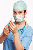Nurse in blue dress with Op stethoscope and syringe as Cut Royalty Free Stock Photo