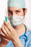 Nurse in blue dress with Op stethoscope and syringe as Cut Royalty Free Stock Photos