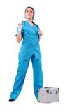 Nurse in blue uniform and with a stethoscope. Woman - a nurse in blue uniform and with a stethoscope and suitcase royalty free stock photography