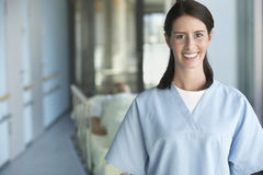 Nurse With Blurred Patient In Hospital Corridor Stock Photos