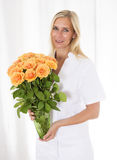 Nurse bringing flowers Stock Photos