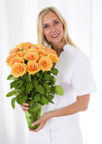 Nurse bringing flowers Stock Image