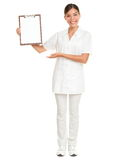 Nurse care therapist showing clipboard white sign royalty free stock photography