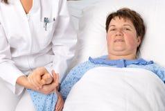 Nurse cares for a elderly woman Stock Photos