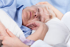 The nurse cares for old lady. The nurse cares for a sick old lady Royalty Free Stock Images