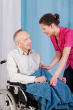 Nurse caring about disabled man Royalty Free Stock Photo