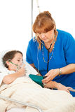 Nurse Caring for Sick Child Royalty Free Stock Photography