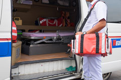 Nurse carry nursing bag standing beside ambulance prepare for he Royalty Free Stock Photo