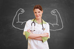 Nurse with chalk muscles. Self confident nurse woman with chalk muscles Stock Photos