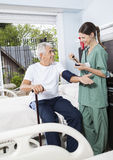Nurse Checking Blood Pressure Of Patient In Rehab Center Stock Image