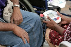Nurse checking BP level of man. In a medical camp during happy roads program(vehicular Traffic stopped) in necklace road on February 28,2015 in Hyderabad,India Royalty Free Stock Photo