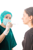 Nurse checking a patient's temperature Royalty Free Stock Photos
