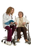 Nurse Checking with Senior on Wheelchair Isolated Stock Image