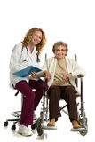 Nurse Checking with Senior on Wheelchair Isolated Stock Images
