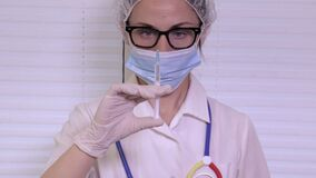 Nurse checking syringe before injection. In room stock video footage
