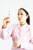 Nurse and syringe Stock Image