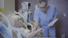 Nurse checks on new patient